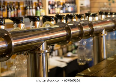 Draught beer taps in a pub