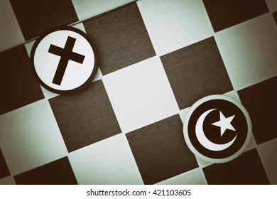 Draughts (Checkers) - Islam vs Christianity - religious tension and conflict between two monotheistic religions and believers, muslims and christians (dramatic light: underexposure, vignetting)
