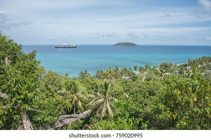 DRAVUNI ISLAND, FIJI/PACIFIC ISLANDS-NOVEMBER 29, 2016: View from tropical mountain top of Holland America Line cruise ship in the Pacific Ocean off the coast of Dravuni Island, Fiji