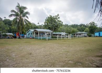 DRAVUNI ISLAND, FIJI/PACIFIC ISLANDS-NOVEMBER 29,2016: Dravuni Primary School with architecture, lush greenery and people on Dravuni Island in Fiji.