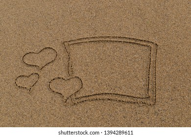 draw heart shapes picture on the sand at the beach by the sea in the summer for holiday concept.