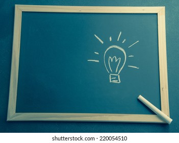 Draw Lamp Idea on Blackboard