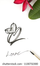 Draw a ring with a heart shape in the middle, a black line with a brush on a white paper.