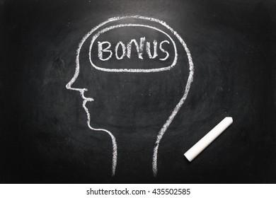Draw the shape of a human head on the blackboard ( bonus money in the brain )