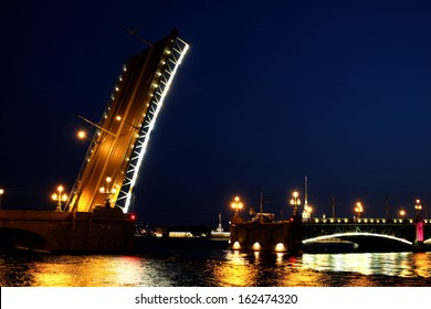 Drawbridge in St. Petersburg at night in the light of lanterns