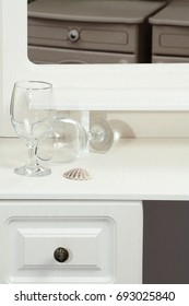 Drawer in the background of the dressing table