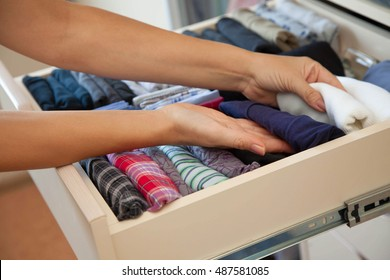 The drawer with underwear in the closet. Men's Clothing lying in the locker room. The order in the men's wardrobe.