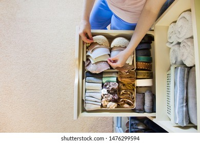 Drawer with underwear, socks, bras and bedding in the closet. Women's Clothing lying in the locker room.