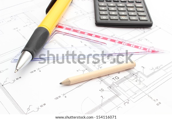 Drawing accessories and calculator on construction drawing of house