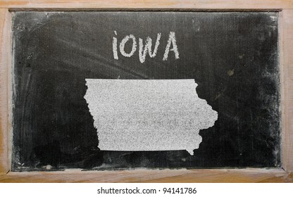 drawing of american state of iowa on chalkboard, drawn by chalk