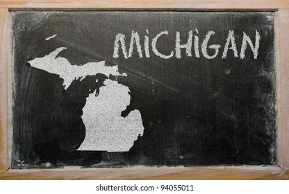 drawing of american state of michigan on chalkboard, drawn by chalk