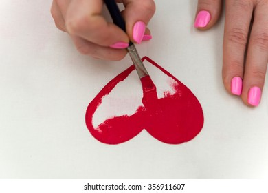 Drawing a beautiful red heart with a brush