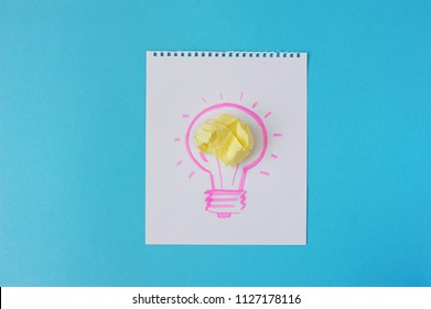 The drawing of a bulb on a white background. Idea, bulb, color crumpled paper.