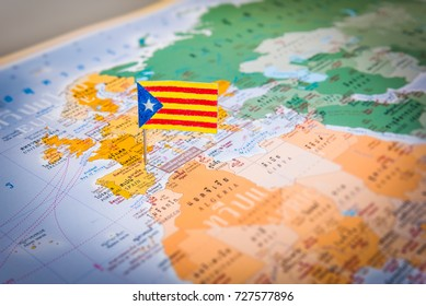 The drawing of Catalonia flag pinning on the Spain map. The concept of protesting, politics, government and Declaration of independence.