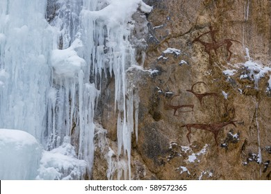 drawing in the cave. on the wall rock. ice waterfall. People hunt animals, hunting. prehistoric man, neanderthal, primitive, cave man. stone age, ice age.
