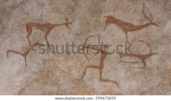 Drawing in a cave painted by an ancient man on a wall, a rock. Paints red ocher. Hunting for an animal. Aboriginal, Neanderthal, cave man. The Stone Age, the Ice Age. Science, anthropology.