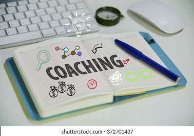 drawing COACHING  concept on notebook in the office , business concept , business idea