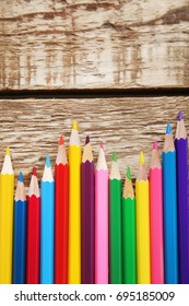 Drawing colourful pencils on brown wooden table