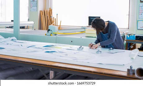 Drawing and cutting in a Japanese garment factory - Shutterstock ID 1669753729