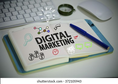 drawing DIGITAL MARKETING  concept on notebook in the office , business concept , business idea