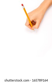 drawing hand with some pencils and a sharpener