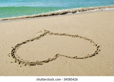 drawing hearts on sand