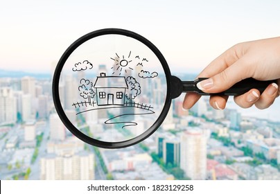 Drawing houses and magnifying glass. Search for housing and apartments concept