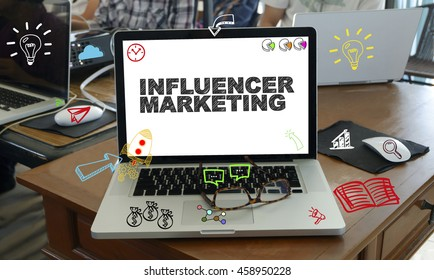 drawing icon cartoon with INFLUENCER MARKETING  concept on laptop in the office , business concept