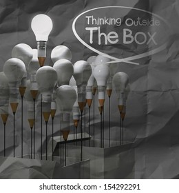 drawing idea pencil and light bulb concept outside the box as creative on crumpled paper