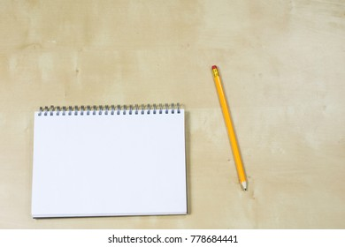 Drawing instruments and a notebook on the work table. Accessories for designing and sketching on a wooden drawing board. White background.