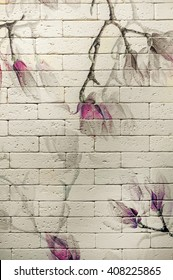 Drawing on a brick wall flower , magnolia, the background
