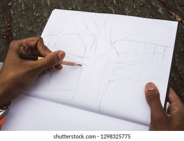Drawing with pencil on paper.