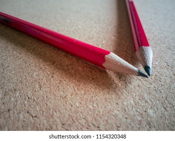 Drawing pencils on a wooden background woth natural light.