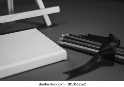 Drawing pencils with wooden easel; Black and white style - Shutterstock ID 1810662562