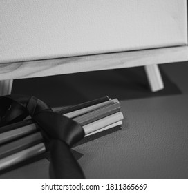 Drawing pencils with wooden easel; Black and white style - Shutterstock ID 1811365669