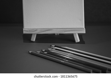 Drawing pencils with wooden easel; Black and white style - Shutterstock ID 1811365675