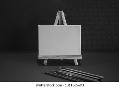 Drawing pencils with wooden easel; Black and white style - Shutterstock ID 1811365690