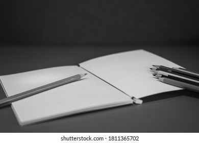 Drawing pencils with wooden easel; Black and white style - Shutterstock ID 1811365702