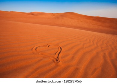 drawing of romantic heart in the arabic sand desert. love concept