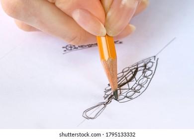 Drawing sketch jewelry on paper . Drawing Jewelry Design. Design Studio. Creativity Ideas.