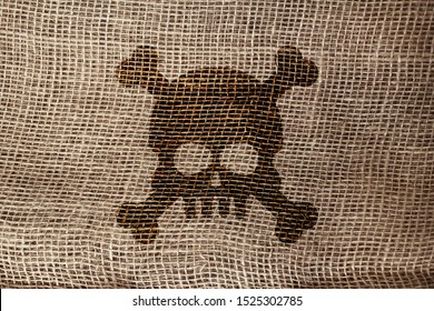 drawing, skull symbol on a natural canvas background, burlap with large weave, background and texture, close-up, copy space