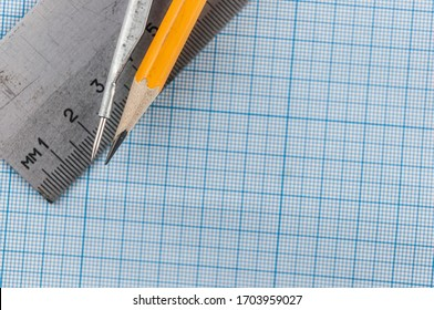 drawing tools: pencil; and ruler on graph paper background with copy space