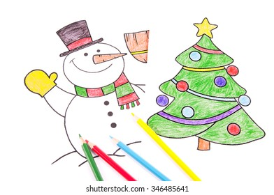 Drawings of a Christmas tree and a snowman with colored crayons