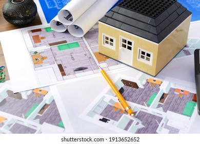 Drawings, layout of the house, documents, calculator on the desktop in the office. Engineering, construction, business.