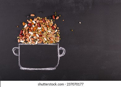 Drawn pot and real pulses on the chalkboard with copy-space