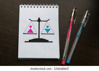 drawn scales with male and female sign. concept of gender equality