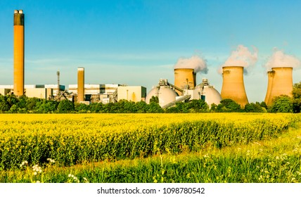 Drax, North Yorkshire, England. May 20 2018 Drax Power Station and Biomass Plant at Drax in North Yorkshire with colourful yellow rapeseed fields and blue sky Landscape