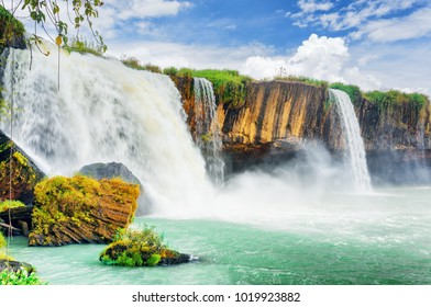 The Dray Nur Waterfall on the Serepok River at the Tay Nguyen (the Central Highlands) in Dak Lak Province (Daklak) of Vietnam. Scenic summer landscape with emerald pond and blue sky.