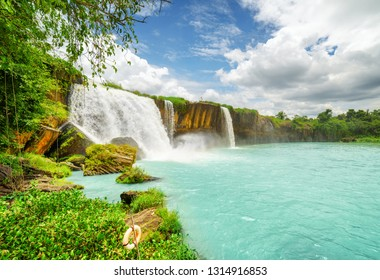 The Dray Nur Waterfall on the Serepok River at the Tay Nguyen (the Central Highlands) in Dak Lak Province (Daklak) of Vietnam. Scenic summer landscape with pond and cloudy sky.