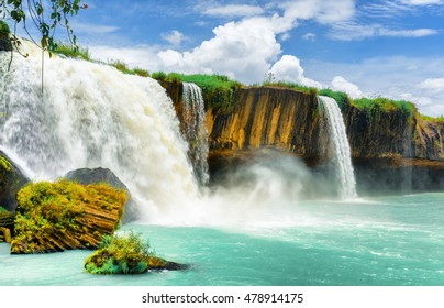 The Dray Nur Waterfall on the Serepok River at the Tay Nguyen (the Central Highlands) in Dak Lak Province (Daklak) of Vietnam. Amazing summer landscape with emerald pond and blue sky.
